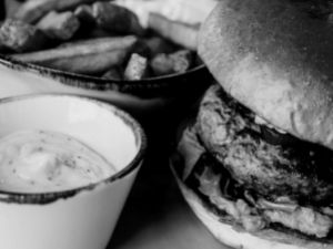 Burger with homemade chips and dip